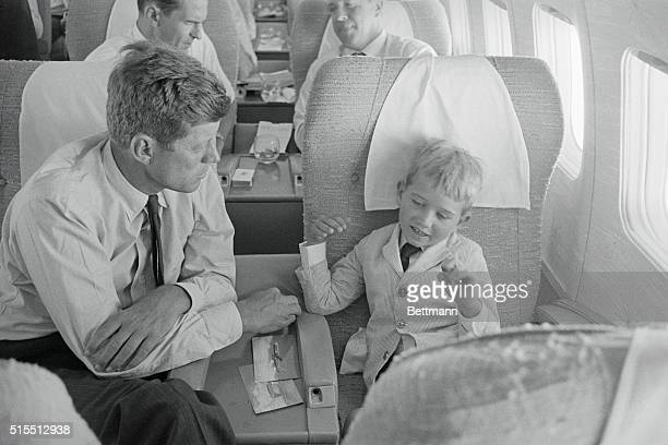 John Kennedy listens to his nephew Bobby Kennedy Jr. Explain how the plane flies from Los Angeles to Boston as they return home from the Democratic...