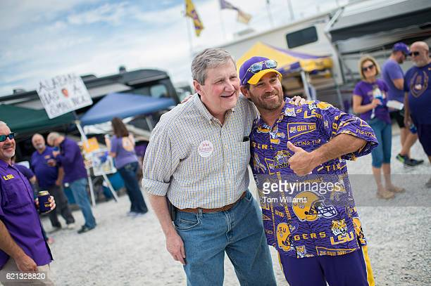 John Kennedy Republican candidate for the US Senate from Louisiana greets a fan at a tailgate before a football game between the Louisiana State...
