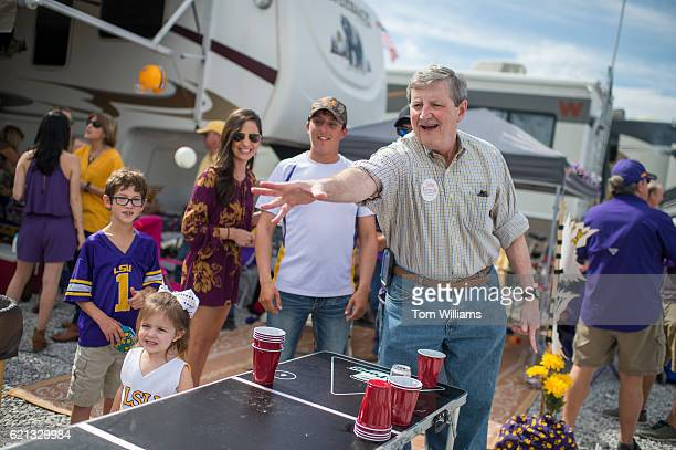 John Kennedy Republican candidate for the US Senate from Louisiana throws a ball during a game of beer pong while greeting fans at tailgate parties...