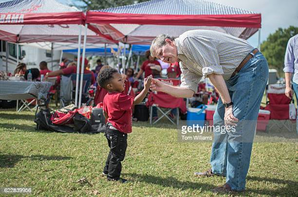John Kennedy Republican candidate for the US Senate from Louisiana greets a fan at a tailgate party before a football game between the Louisiana...