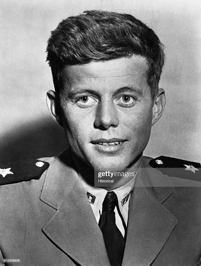 John Kennedy served as a junior grade lieutenant in the Navy during World War Two, commanding the torpedo boat PT-109. When a Japanese destroyer rammed the PT-109 in 1943, Kennedy managed to save himself and rescue another wounded crew member. | Location: indoors.
