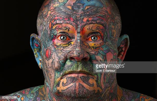 John Kenney poses for a portrait in his home on April 28 2016 in Melbourne Australia The 60 year old has tattoos all over his body including his...