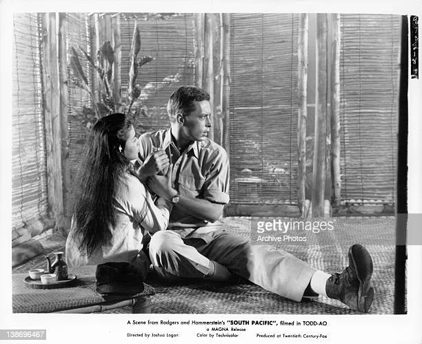 John Kerr holding onto France Nuyen in a scene from the film 'South Pacific' 1958