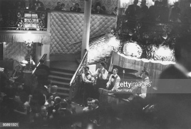 John Kerrison's rhumba-style band plays on a busy evening at the Cafe de Paris nightclub in London, February 1951. Original publication: Picture Post...