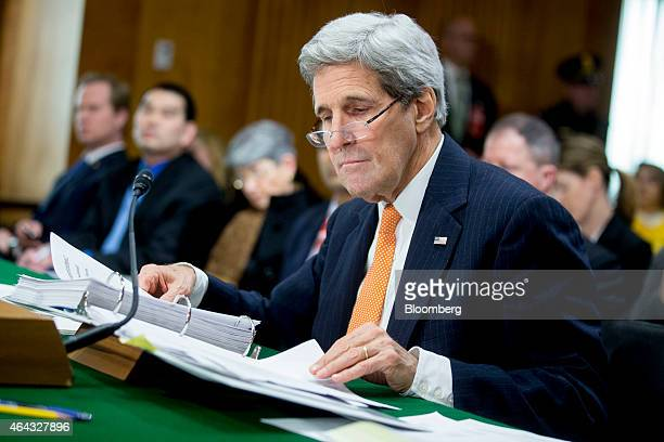 John Kerry US secretary of state looks through a binder during a Senate Foreign Relations Committee in Washington DC US on Tuesday Feb 24 2015 Kerry...