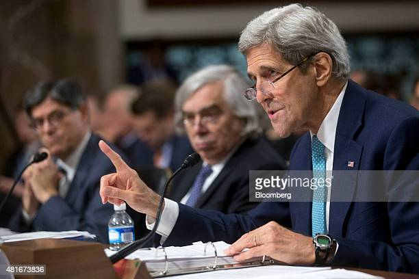 John Kerry US secretary of state right speaks during a Senate Foreign Relations Committee hearing with Ernest Moniz US secretary of energy center and...