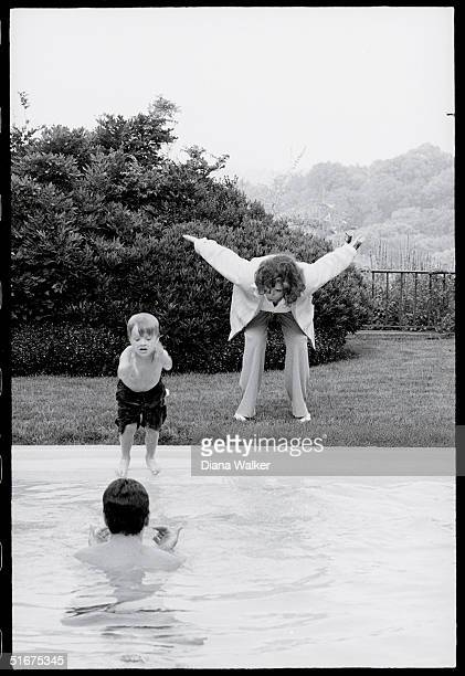 John Kerry's wife Teresa Heinz Kerry and son Chris teaching Jack Edwards,young son of Senator John Edwards, how to dive into the pool at Rosemont...