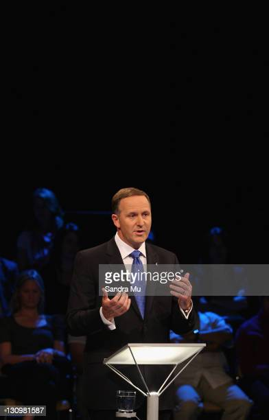 John Key Leader of the National Party debates with Phil Goff Leader of the Labour Party at the TVNZ studios on October 31 2011 in Auckland New...