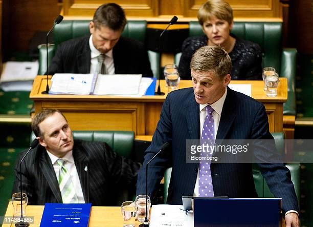 John Key New Zealand's prime minister bottom left listens as Bill English New Zealand's finance minister bottom right reads the budget in Parliament...