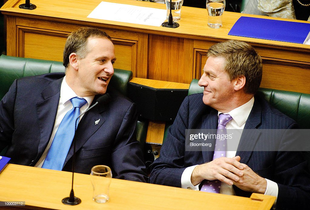 John Key, New Zealand's prime minister, left, speaks with Bill English, New Zealand's finance minister, after the presentation of the budget in Parliament, in Wellington, New Zealand, on Thursday, May 20, 2009. New Zealand will raise sales tax for the first time in two decades and lower income taxes to encourage household saving, aiming to reduce the economy's 'vulnerability' to concerns about sovereign debt. Photographer: Mark Coote/Bloomberg via Getty Images