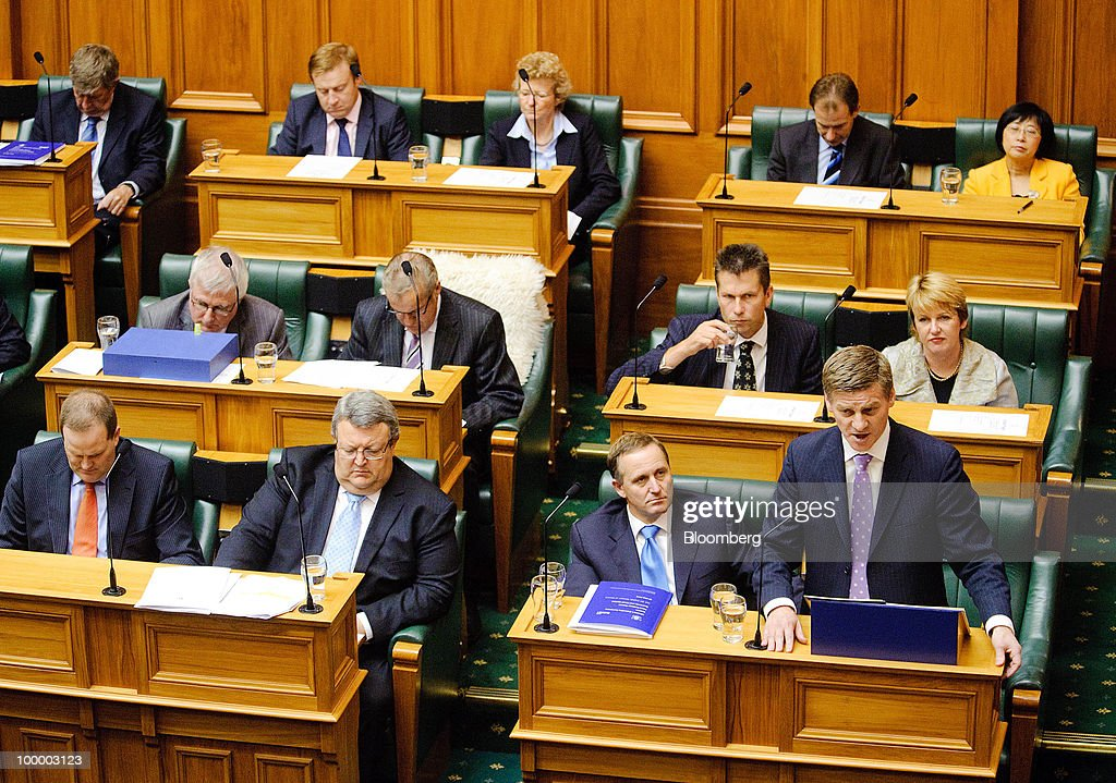 John Key, New Zealand's prime minister, second from bottom right, listens as Bill English, New Zealand's finance minister, standing bottom right, reads the budget in Parliament, in Wellington, New Zealand, on Thursday, May 20, 2009. New Zealand will raise sales tax for the first time in two decades and lower income taxes to encourage household saving, aiming to reduce the economy's 'vulnerability' to concerns about sovereign debt. Photographer: Mark Coote/Bloomberg via Getty Images
