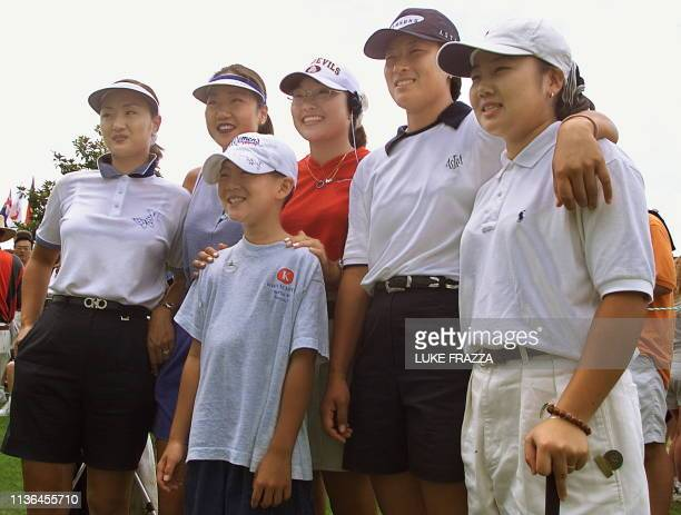 John Kim a 10 year old golf fan from Memphis TN poses on the practice green before a practice round with five Korean golfers who are playing in the...