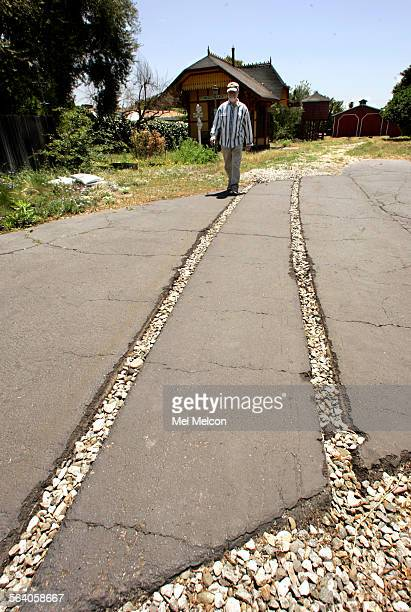 John Kimball walks the grounds of what used to be the Grizzly Flats railroad located in backyard of his parent's home in San Gabriel on May 3 2007...