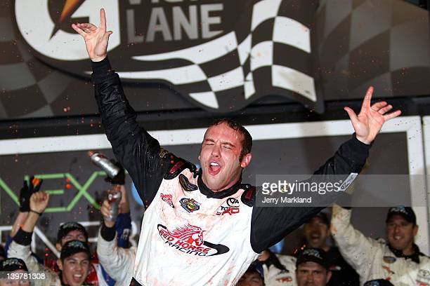 John King driver of the Red Horse Racing Toyota celebrates in Victory Lane after winning the NASCAR Camping World Truck Series NextEra Energy...