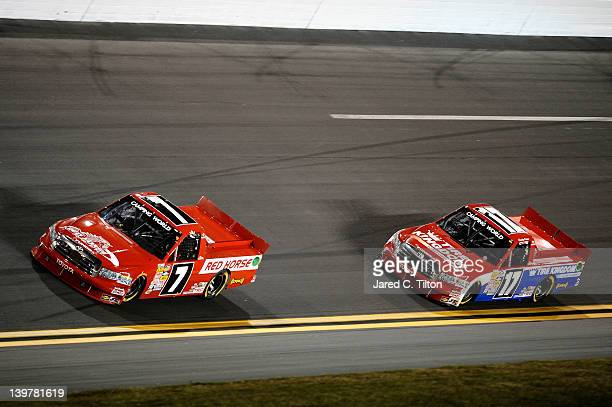 John King driver of the Red Horse Racing Toyota leads Timothy Peters driver of the Tire Kingdom/Service Central Toyota during the NASCAR Camping...