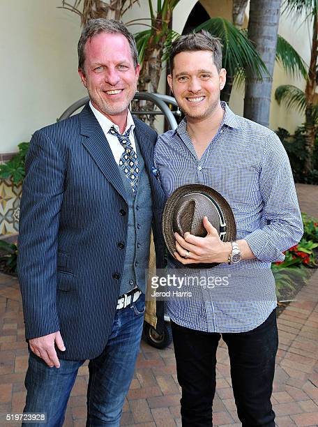 John Kirkpatrick and singer Michael Buble attend PTTOW Summit at Terranea Resort on April 4 2016 in Rancho Palos Verdes California