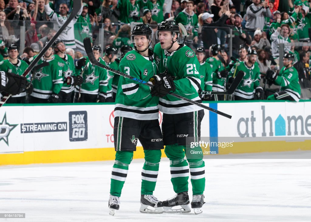 John Klingberg #3 and Esa Lindell #23 of the Dallas Stars celebrate a goal against the Pittsburgh Penguins at the American Airlines Center on February 9, 2018 in Dallas, Texas.