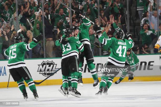 John Klingberg and the Dallas Stars celebrate a game winning overtime goal against the Nashville Predators in Game Six of the Western Conference...