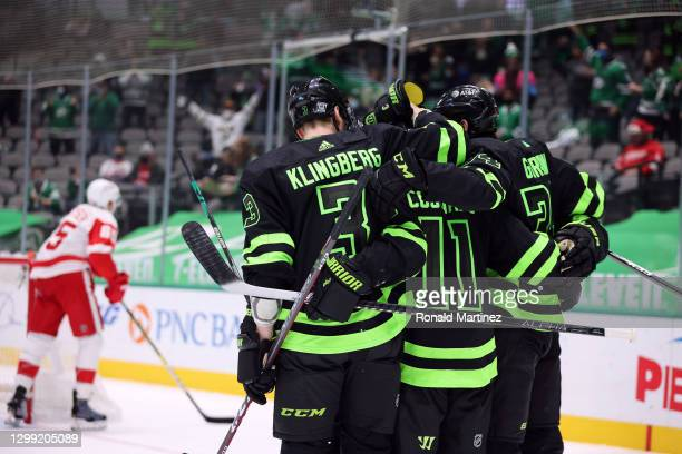 John Klingberg, Andrew Cogliano and Denis Gurianov of the Dallas Stars celebrate a goal against the Detroit Red Wings in the second period at...