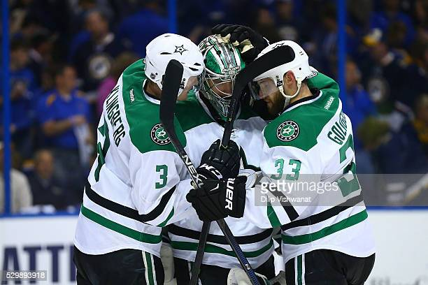 John Klingberg Kari Lehtonen and Kari Lehtonen of the Dallas Stars celebrate after beating the St Louis Blues in Game Six of the Western Conference...