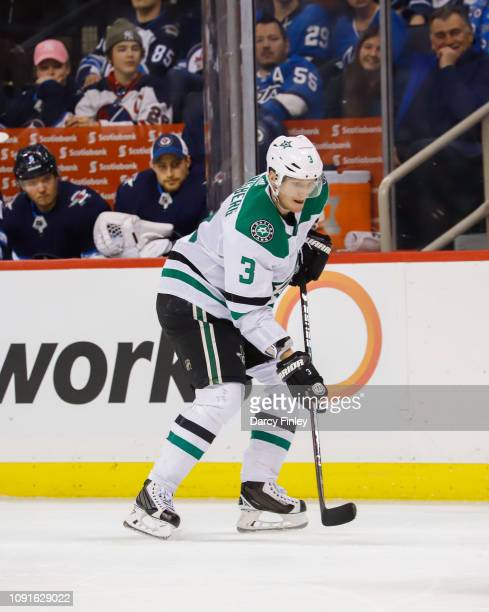 John Klingberg of the Dallas Stars follows the play down the ice during third period action against the Winnipeg Jets at the Bell MTS Place on...