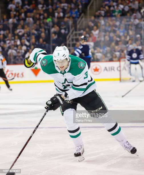 John Klingberg of the Dallas Stars follows the play down the ice during second period action against the Winnipeg Jets at the Bell MTS Place on...