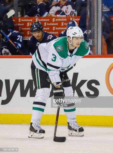 John Klingberg of the Dallas Stars gets set during a third period faceoff against the Winnipeg Jets at the Bell MTS Place on January 6 2019 in...