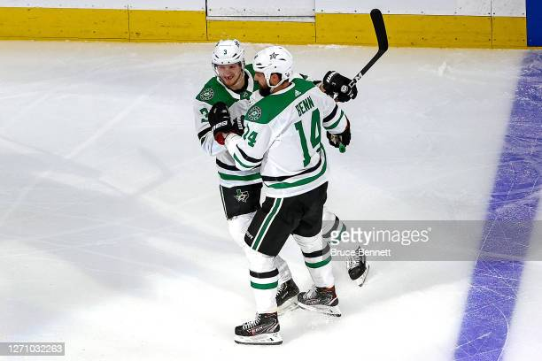 John Klingberg of the Dallas Stars is congratulated by Jamie Benn after scoring a goal against the Vegas Golden Knights during the first period in...