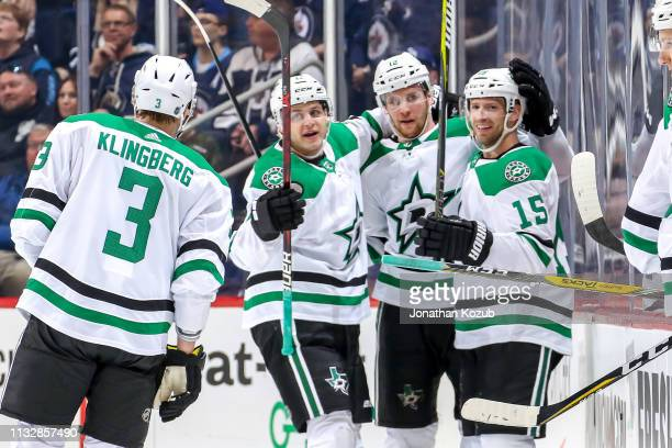 John Klingberg of the Dallas Stars joins teammates Mattias Janmark Radek Faksa and Blake Comeau as they celebrate a second period goal against the...