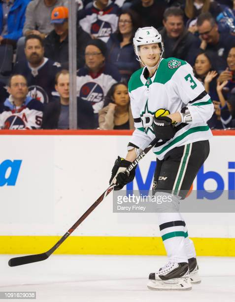John Klingberg of the Dallas Stars keeps an eye on the play during first period action against the Winnipeg Jets at the Bell MTS Place on January 6...