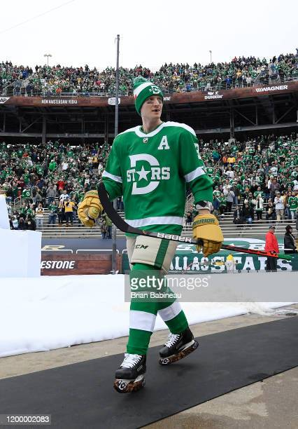John Klingberg of the Dallas Stars walks to the ice for warmup prior to the 2020 NHL Winter Classic between the Nashville Predators and the Dallas...