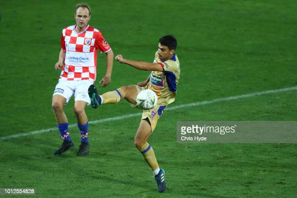 John Koutroumbis of the Jets kicks during the FFA Cup round of 32 match between Gold Coast Knights and Newcastle Jets at XXXX on August 7, 2018 in...