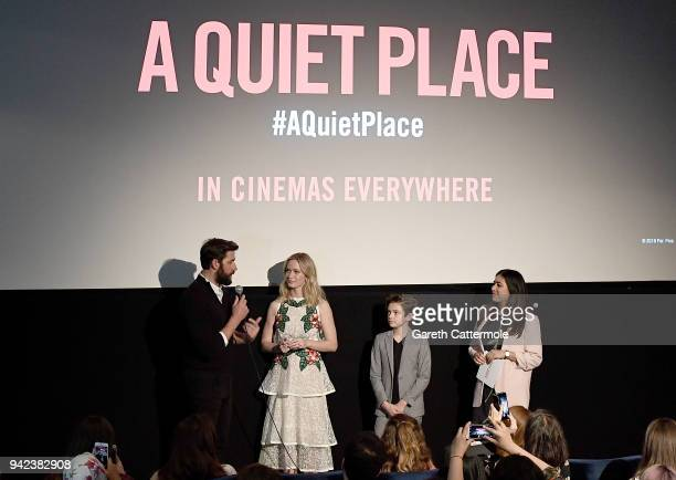 John Krasinski Emily Blunt Noah Jupe and host on stage at an immersive VIP Fan Screening of 'A Quiet Place' on April 5 2018 in London England