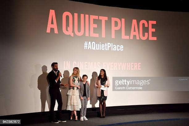 John Krasinski, Emily Blunt, Noah Jupe and host Rhianna Dhillon on stage at an immersive VIP Fan Screening of 'A Quiet Place' on April 5, 2018 in...