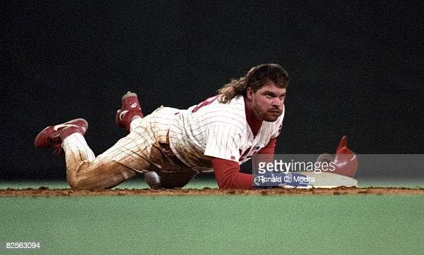 John Kruk of the Philadelphia Phillies slides into second base during the National League Championship Series against the Atlanta Braves on October 6...