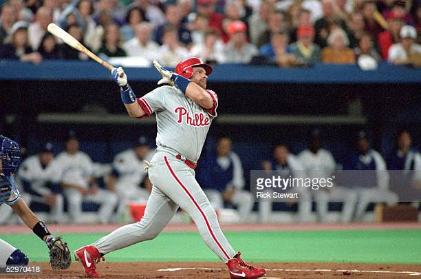 John Kruk of the Philadelphia Phillies swings at a pitch during Game one of the 1993 World Series against the Toronto Blue Jays at Skydome on October...