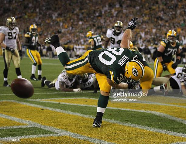 John Kuhn of the Green Bay Packers spikes the ball after scoring a touchdown against the New Orleans Saints during the NFL opening season game at...