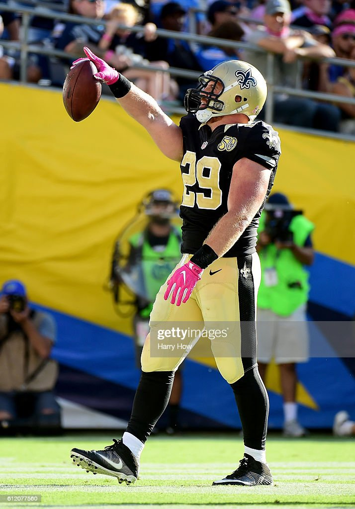 John Kuhn #29 of the New Orleans Saints celebrates his touchdown to tie the score 34-34 and a 35-34 lead after the extra point attempt during the fourth quarter at Qualcomm Stadium on October 2, 2016 in San Diego, California.