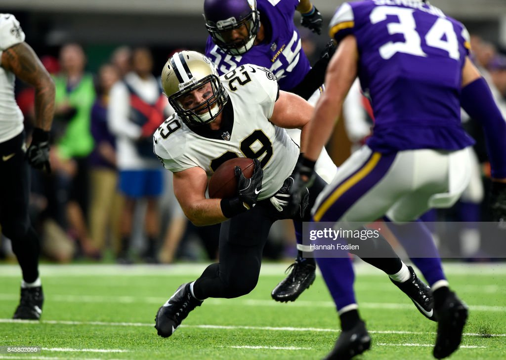 John Kuhn #29 of the New Orleans Saints stumbles with the ball in the first half of the game against the Minnesota Vikings on September 11, 2017 at U.S. Bank Stadium in Minneapolis, Minnesota.