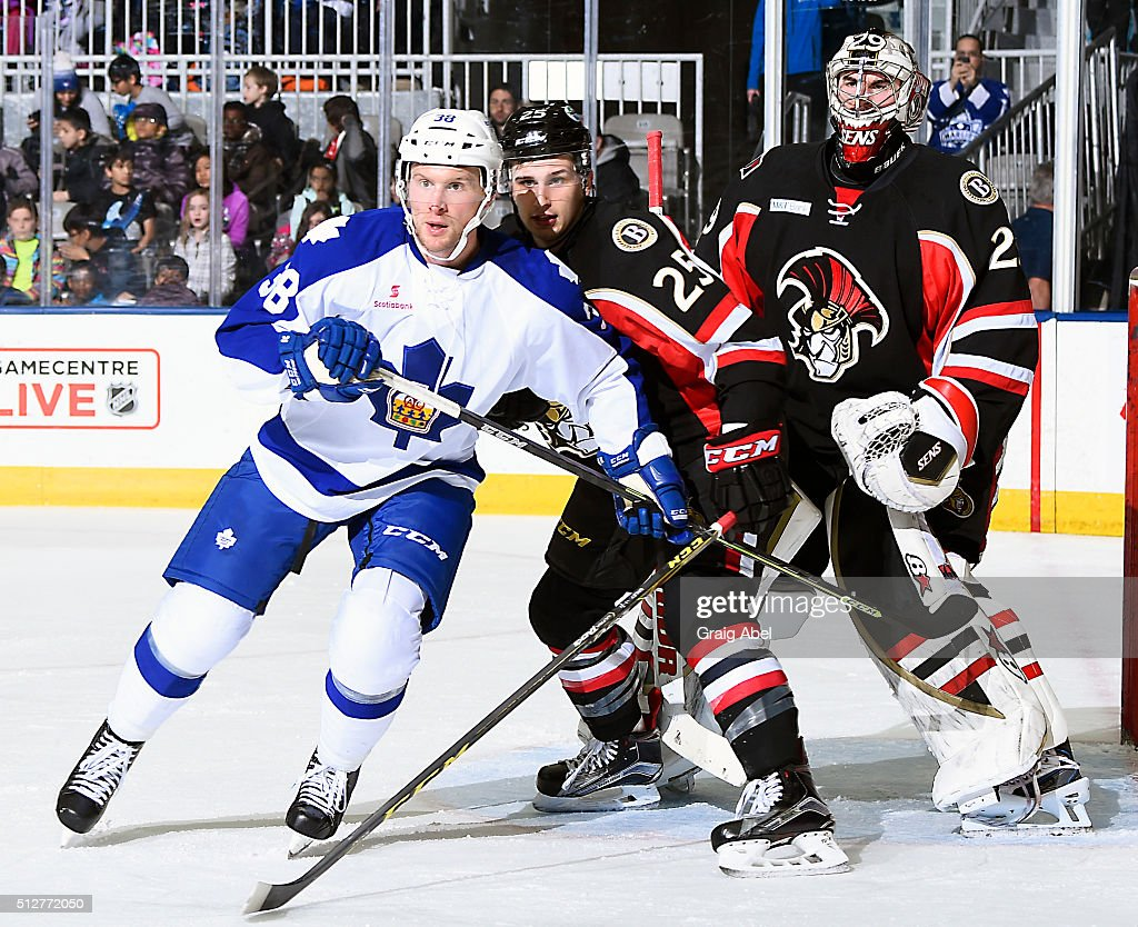John Kurtz #38 of the Toronto Marlies battles for crease space with Casey Bailey #25 and goalie Matt O'Connor #29 of the Binghamton Senators during AHL game action on February 24, 2016 at Ricoh Coliseum in Toronto, Ontario, Canada.
