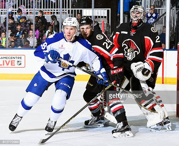 John Kurtz of the Toronto Marlies battles for crease space with Casey Bailey and goalie Matt O'Connor of the Binghamton Senators during AHL game...