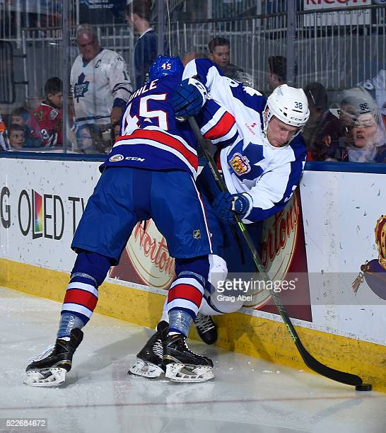 John Kurtz of the Toronto Marlies battles for the puck with Brendan Guhle of the Rochester Americans during AHL game action on April 17 at Ricoh...
