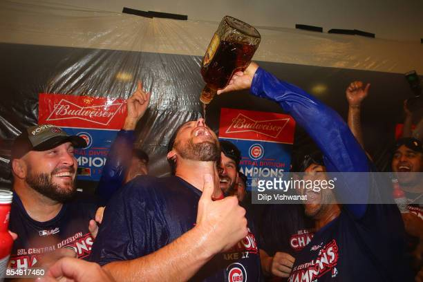 John Lackey of the Chicago Cubs celebrates after winning the National League Central title against the St Louis Cardinals at Busch Stadium on...