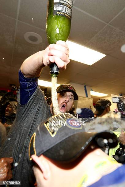 John Lackey of the Chicago Cubs celebrates with teammates in the clubhouse after the Cubs defeated the Cleveland Indians 87 in Game Seven of the 2016...