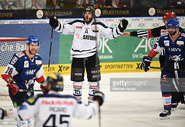 John Laliberte of Ingolstadt celebrates with his team-mates after scoring his team's fifth goal during the DEL Play-offs Final Game 3 between Adler...