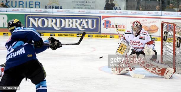 John Laliberte of Ingolstadt shoots against Danny aus den Birken of Koeln in game six of the DEL final playoffs between ERC Ingolstadt and Koelner...