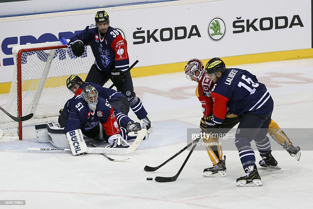 John Laliberte (#15 ERC Ingolstadt) takes a shot on goal at Goalie Timo Pielmeier (#51 ERC Ingolstadt) - Leivo Tomi #11 yellow SAI - Game 2 of 6 during the Champions Hockey League group stage game between ERC Ingolstadt and SaiPa Lappeenranta on August 23, 2014 in Ingolstadt, Germany.
