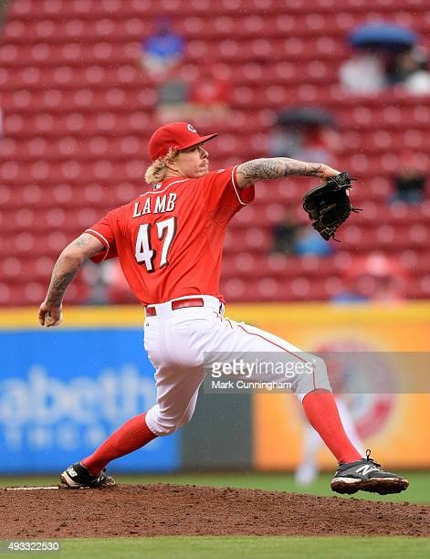 John Lamb of the Cincinnati Reds pitches during the game against the Chicago Cubs at Great American Ball Park on October 1 2015 in Cincinnati Ohio...