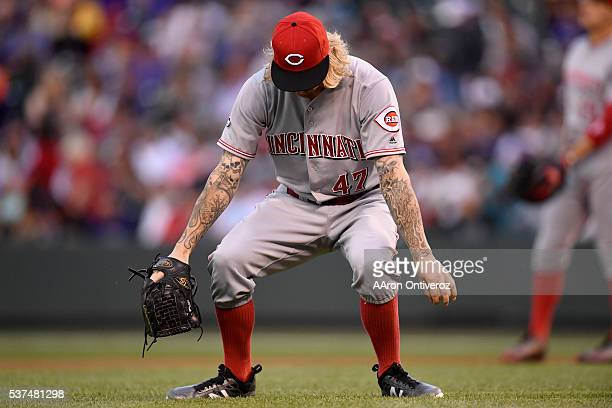 John Lamb of the Cincinnati Reds stretches before pitching against the Colorado Rockies during the second inning at Coors Field The Colorado Rockies...
