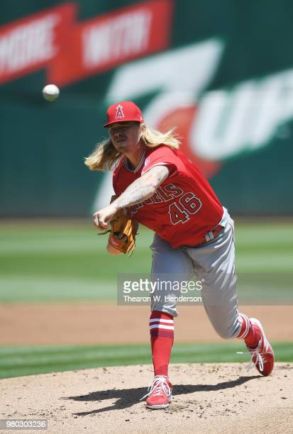 John Lamb of the Los Angeles Angels of Anaheim pitches against the Oakland Athletics in the bottom of the first inning at the Oakland Alameda...